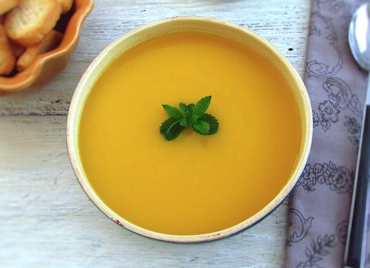 Carrot soup on a dish bowl