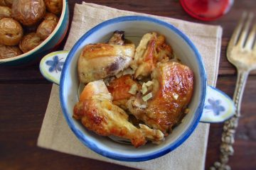 Chicken with golden potatoes on a tureen