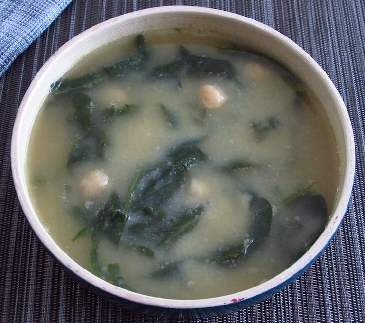 Chickpeas soup with spinach on a dish bowl