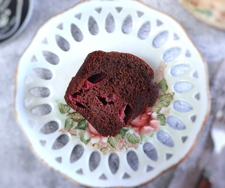 Slice of chocolate cake with strawberries on a plate