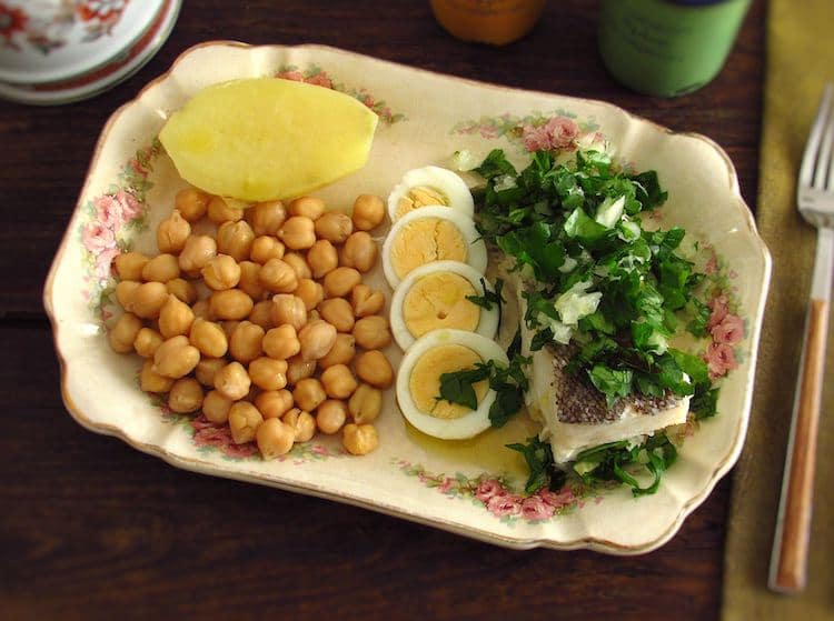 Cooked chickpeas with cod on a platter