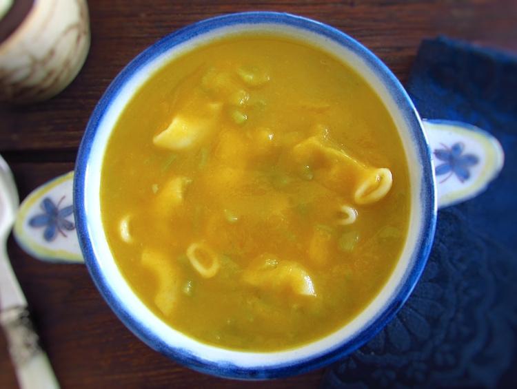 Green bean soup on a soup bowl