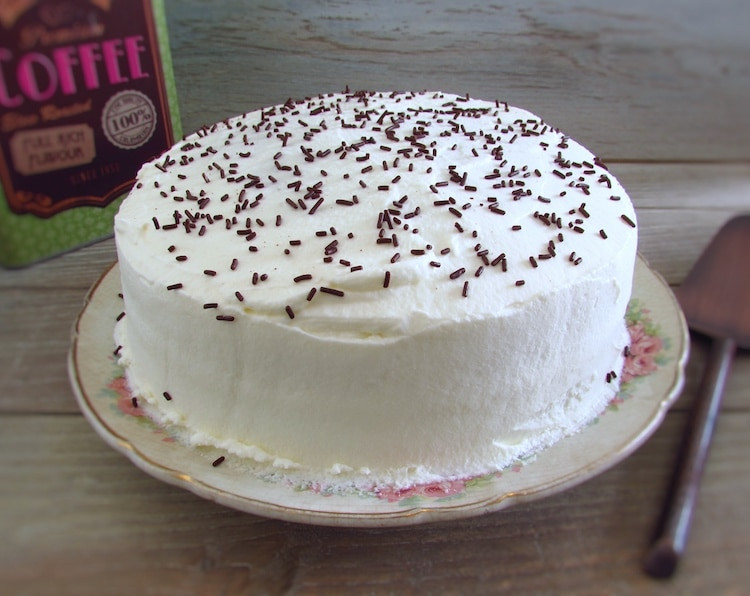 Homemade chocolate cake with chantilly on a plate