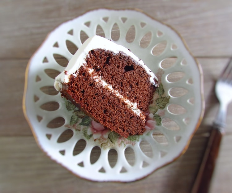 Slice of homemade chocolate cake with chantilly on a dish