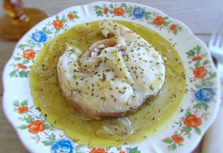 Ling fish with onion on a plate