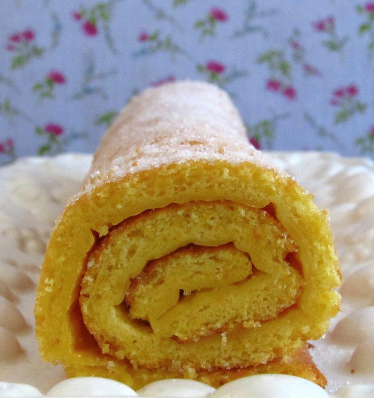 Orange roll cake on a platter