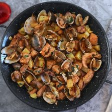 Portuguese pork with clams on a large skillet