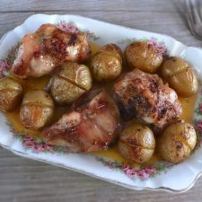 Rabbit with potatoes in the oven on a platter
