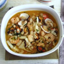 Seafood with white beans on a tureen