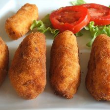 Shrimp and ham croquettes on a plate with salad
