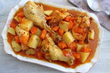 Stewed chicken with potatoes and carrots on a platter