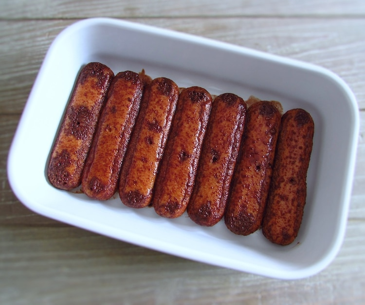 Sponge fingers with a creamy chocolate mixture on a rectangular dish