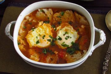 Tomato soup with poached eggs on a tureen