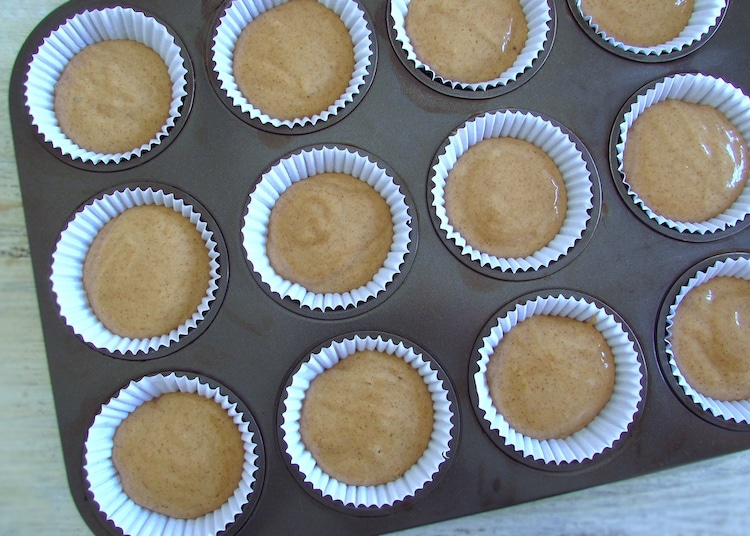 Cinnamon muffins cream on paper liners