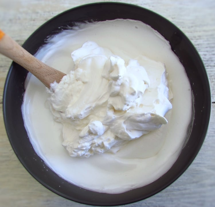 Egg whites mixture with whipped cream on a bowl