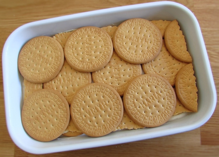Layer of cream and a layer of biscuits on a rectangular dish