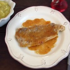 Pork steaks with apple puree on a plate