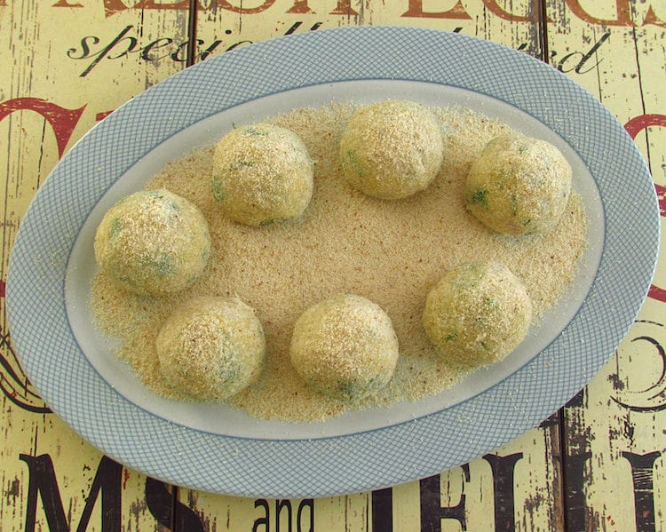 Cod balls coated with breadcrumbs on a platter