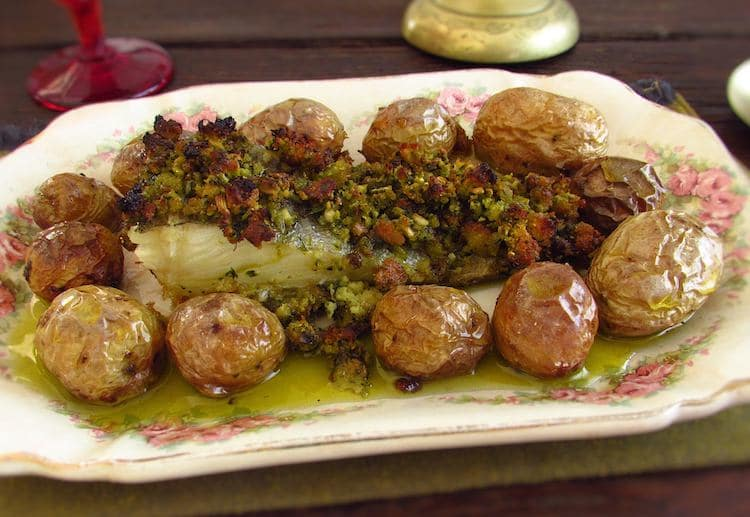 Cod with Portuguese cornbread and potatoes on a platter