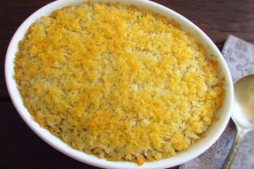 Rice with minced meat in the oven on a baking dish