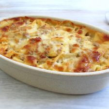 Tagliatelle with minced meat and pineapple in the oven on a baking dish