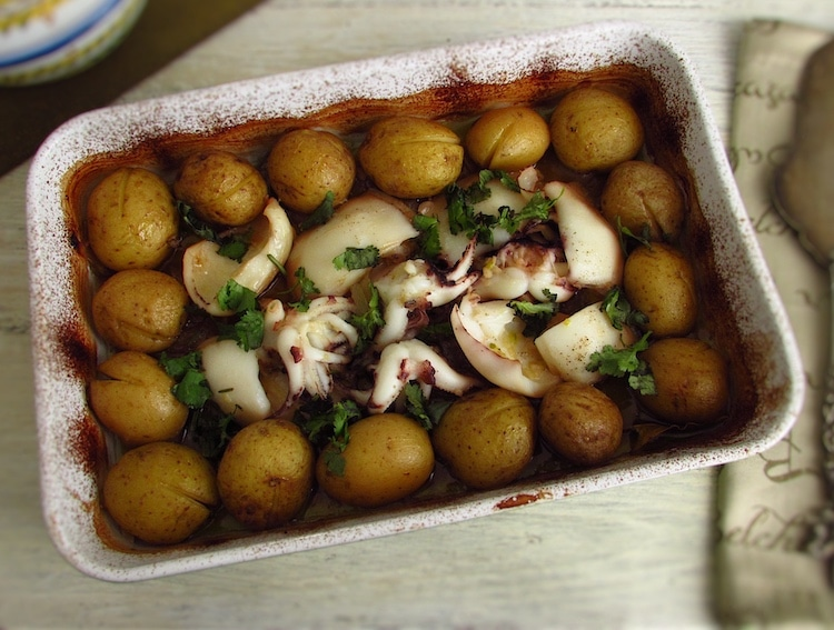Cuttlefish with potatoes in the oven on a baking dish