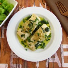 Hake loins with coriander on a plate
