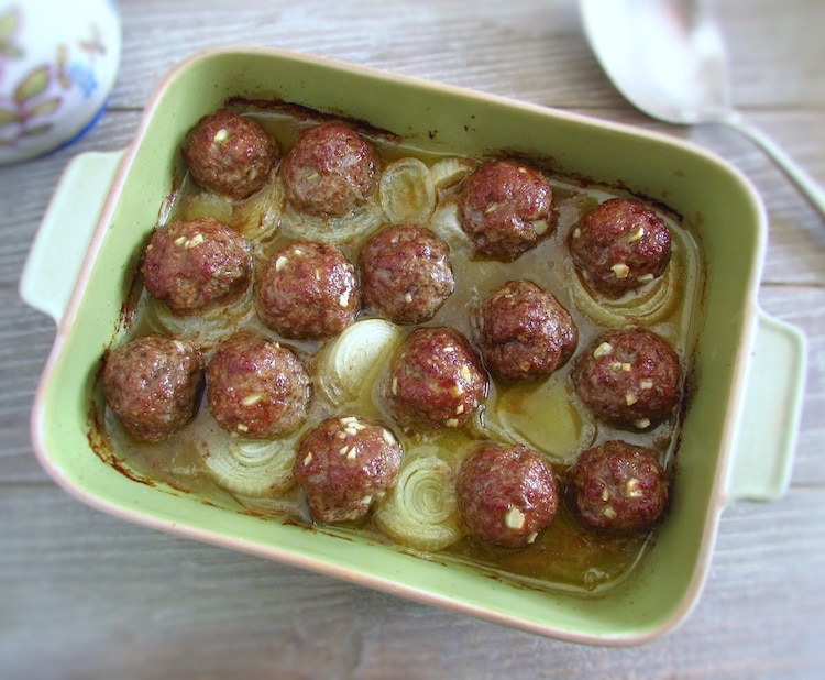 Meatballs in the oven on a baking dish