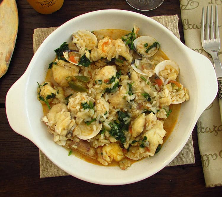 Monkfish rice with clams on a dish bowl