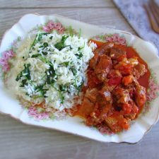 Pork with coriander rice on a platter