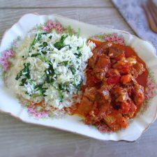 Pork with coriander rice on a platter