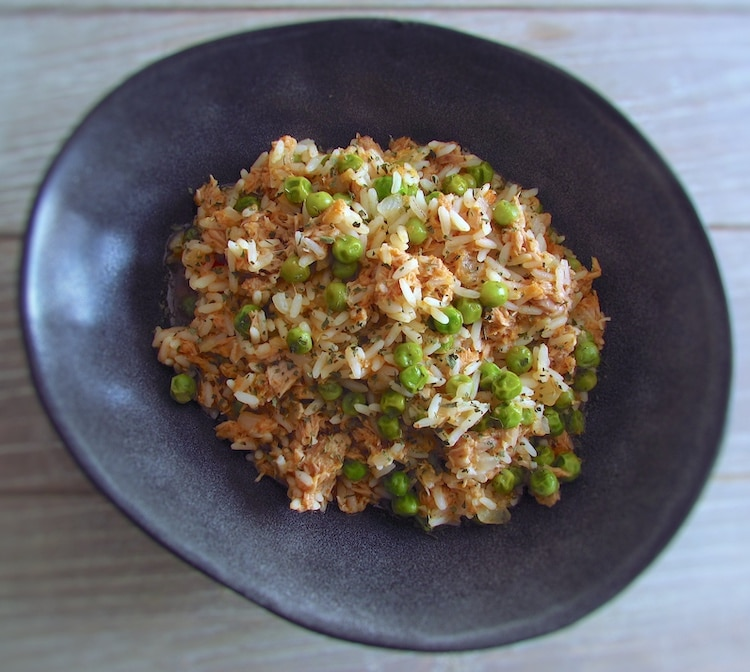 Rice with tuna and peas on a dish bowl