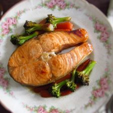 Sautéed salmon with vegetables on a plate