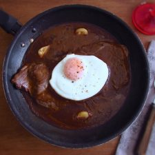 Steak with coffee sauce on a frying pan