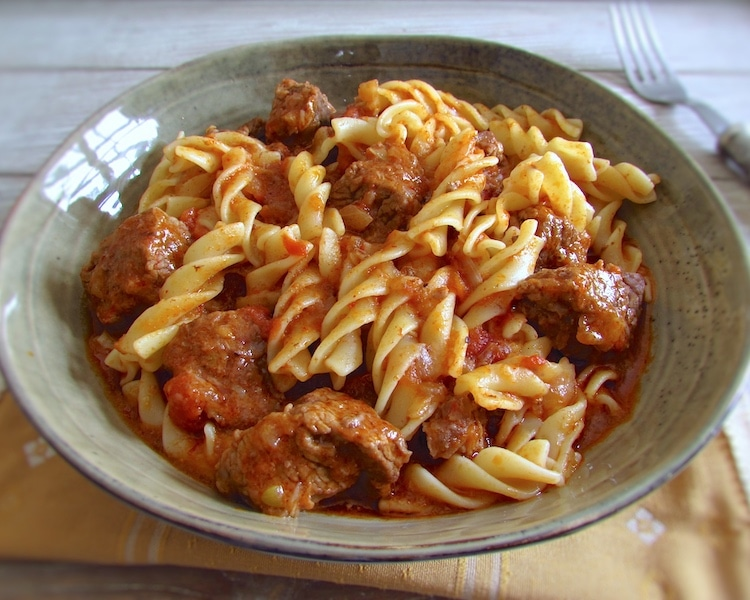 Stewed beef with pasta on a dish bowl