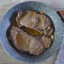 Fried steaks on a frying pan