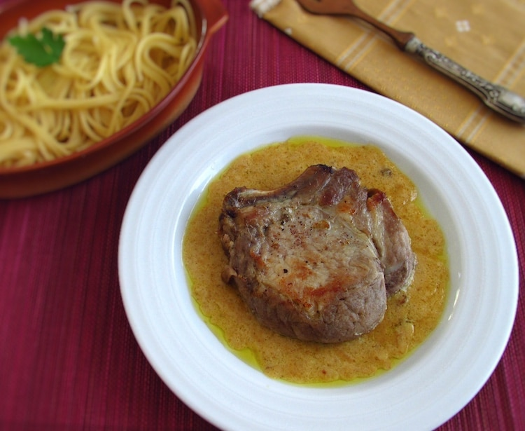 Pork chops with honey mustard sauce on a plate