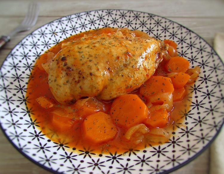 Stewed chicken breast with carrot on a plate