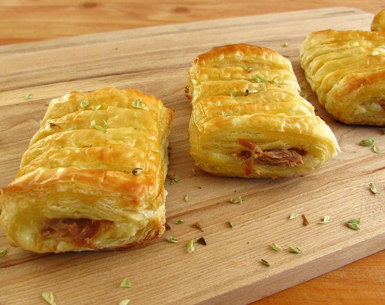 Tuna and cheese puffs on a wooden board