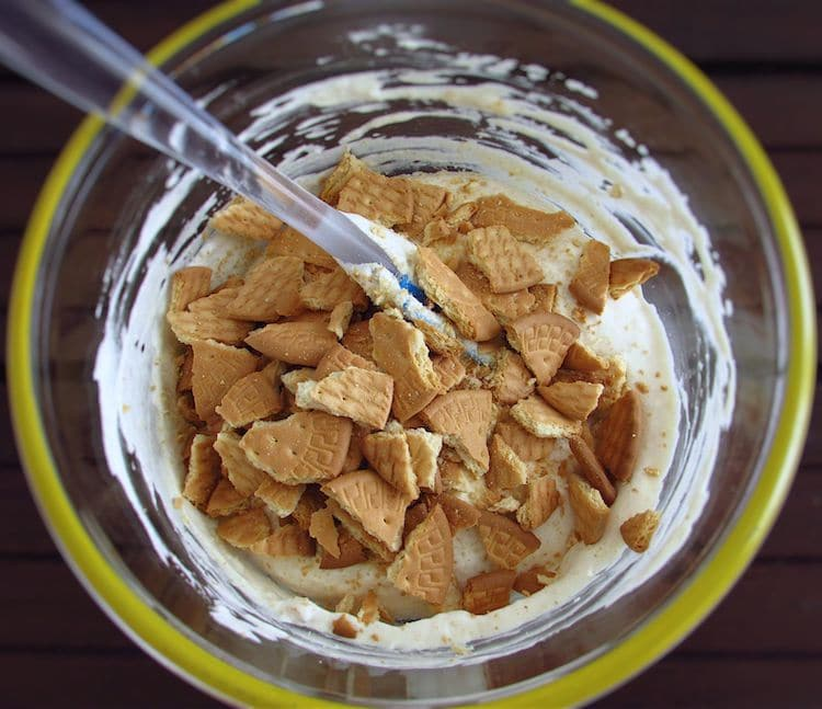 Coffee cream with wafers broken into pieces on glass bowl