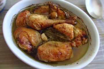 Chicken in the oven on a baking dish