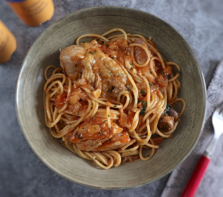 Chicken stew with spaghetti on a bowl