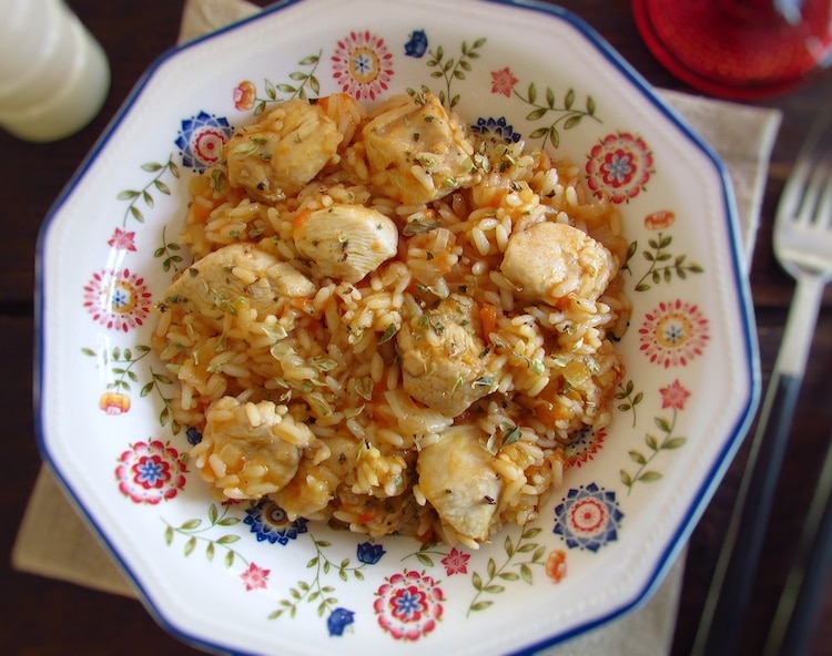 Fried chicken breast with tomato rice on a dish bowl