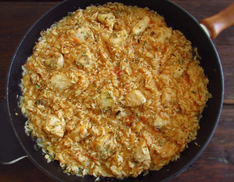 Fried chicken breast with tomato rice on a frying pan