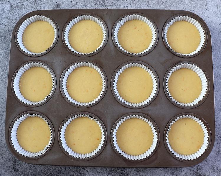 Orange muffins dough in paper liners