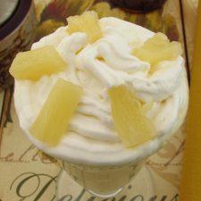 Pineapple and mango milkshake on a glass bowl