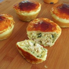 Mini chicken pies on a wooden board