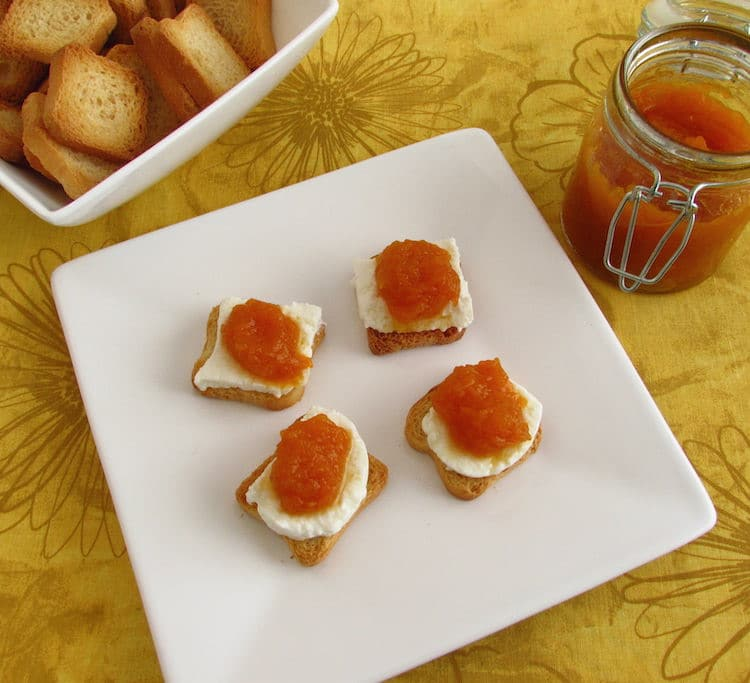 Pumpkin jam with toasts on a plate