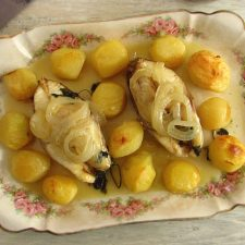 Snapper with potatoes in the oven on a platter