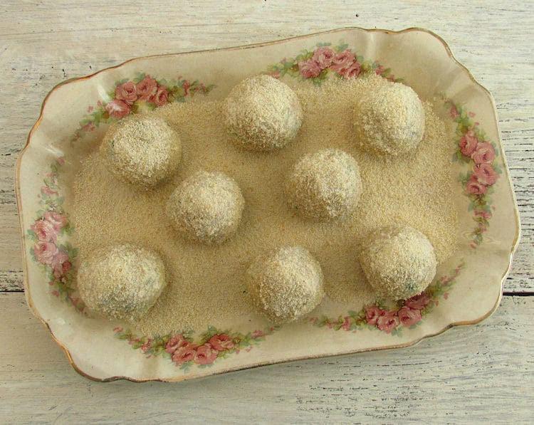 Tuna balls coated with breadcrumbs on a platter
